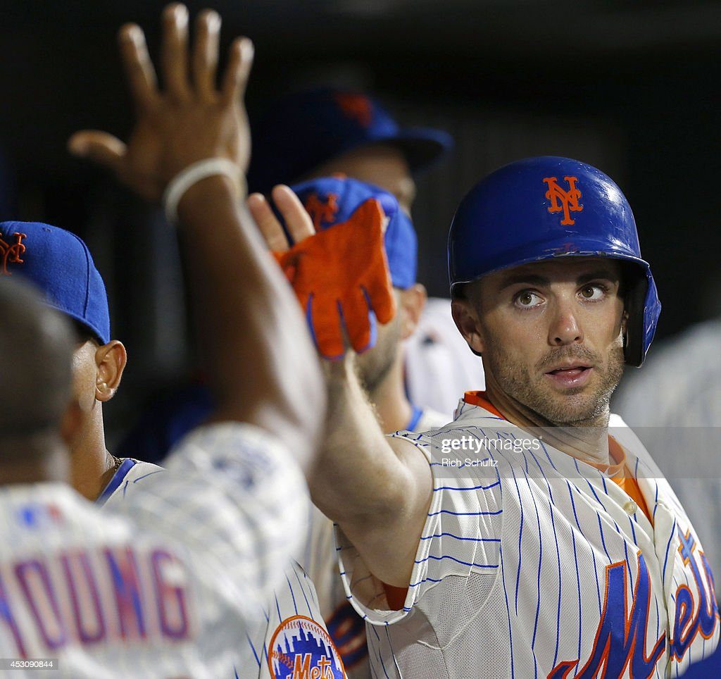 David Wright #5 of the New York Mets is congratulated after scoring in the seventh inning against the San Francisco Giants on August 2, 2014 at Citi Field in the Flushing neighborhood of the Queens borough of New York City. The Mets defeated the Giants 4-2.