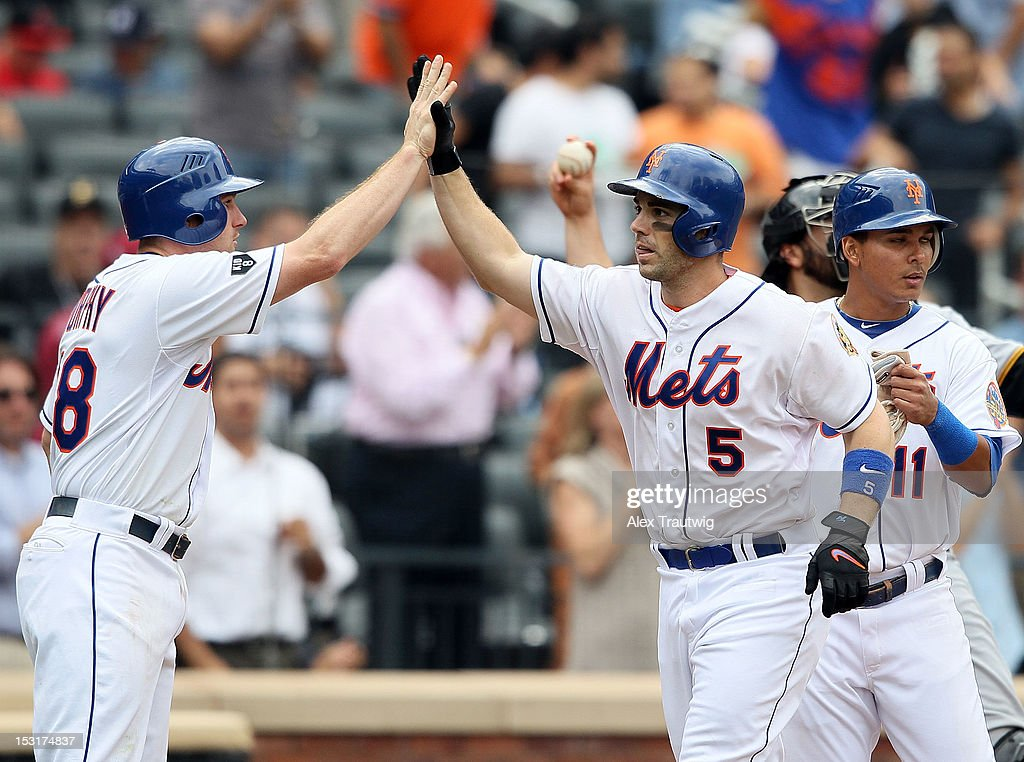 David Wright #5 of the New York Mets is congratulated by Daniel Murphy after hitting a home run against the Pittsburgh Pirates at Citi Field on September 27, 2012 in the Flushing neighborhood of the Queens borough of New York City.