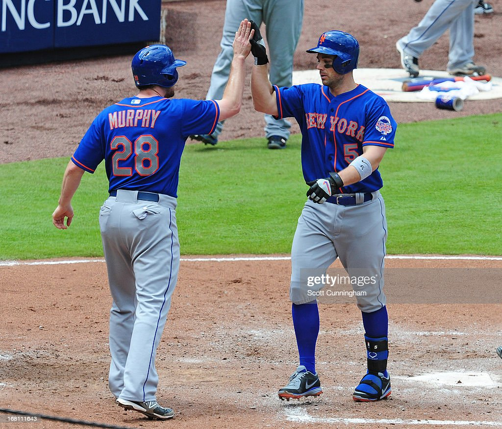 <a gi-track='captionPersonalityLinkClicked' href=/galleries/search?phrase=David+Wright+-+Baseball+Player&family=editorial&specificpeople=209172 ng-click='$event.stopPropagation()'>David Wright</a> #5 of the New York Mets is congratulated by Daniel Murphy #28 after hitting a fourth inning home run against the Atlanta Braves at Turner Field on May 5, 2013 in Atlanta, Georgia.