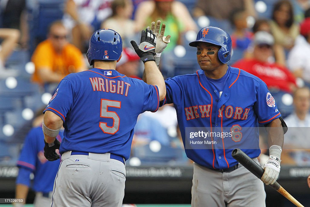 <a gi-track='captionPersonalityLinkClicked' href=/galleries/search?phrase=David+Wright+-+Baseball+Player&family=editorial&specificpeople=209172 ng-click='$event.stopPropagation()'>David Wright</a> #5 of the New York Mets is congratulated by <a gi-track='captionPersonalityLinkClicked' href=/galleries/search?phrase=Marlon+Byrd&family=editorial&specificpeople=217377 ng-click='$event.stopPropagation()'>Marlon Byrd</a> #6 after hitting a solo home run in the ninth inning during a game against the Philadelphia Phillies at Citizens Bank Park on June 23, 2013 in Philadelphia, Pennsylvania. The Mets won 8-0.