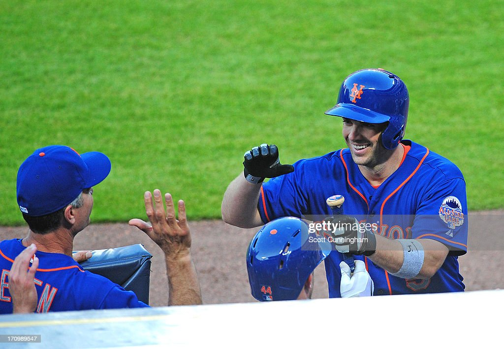 <a gi-track='captionPersonalityLinkClicked' href=/galleries/search?phrase=David+Wright+-+Baseball+Player&family=editorial&specificpeople=209172 ng-click='$event.stopPropagation()'>David Wright</a> #5 of the New York Mets is congratulated by teammates after hitting his second home run of the game against the Atlanta Braves at Turner Field on June 20, 2013 in Atlanta, Georgia.