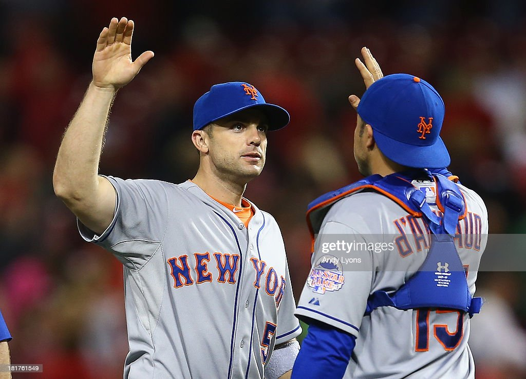 <a gi-track='captionPersonalityLinkClicked' href=/galleries/search?phrase=David+Wright+-+Baseball+Player&family=editorial&specificpeople=209172 ng-click='$event.stopPropagation()'>David Wright</a> #5 of the New York Mets is congratulated by Travis d'Arnaud #15 after the 4-2 Mets victory over the Cincinnati Reds at Great American Ball Park on September 24, 2013 in Cincinnati, Ohio.