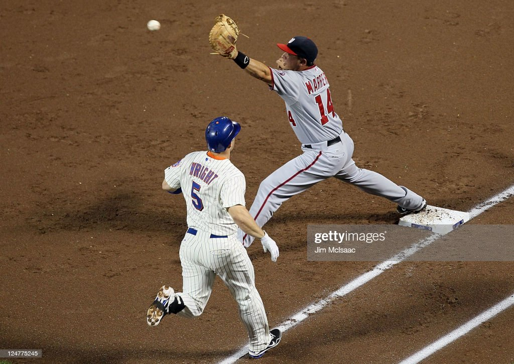 <a gi-track='captionPersonalityLinkClicked' href=/galleries/search?phrase=David+Wright+-+Baseball+Player&family=editorial&specificpeople=209172 ng-click='$event.stopPropagation()'>David Wright</a> #5 of the New York Mets is forced out at first base by Chris Marrero #14 of the Washington Nationals at Citi Field on September 12, 2011 in the Flushing neighborhood of the Queens borough of New York City.