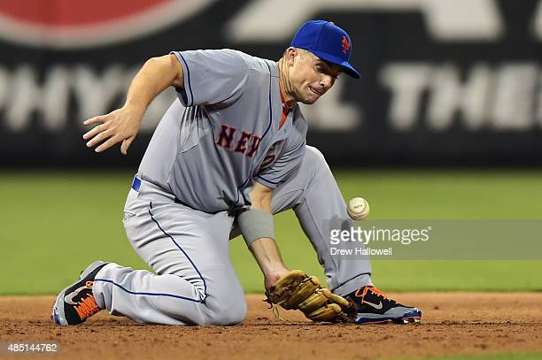 David Wright of the New York Mets is unable to catch a line drive in the fifth inning against the Philadelphia Phillies at Citizens Bank Park on...