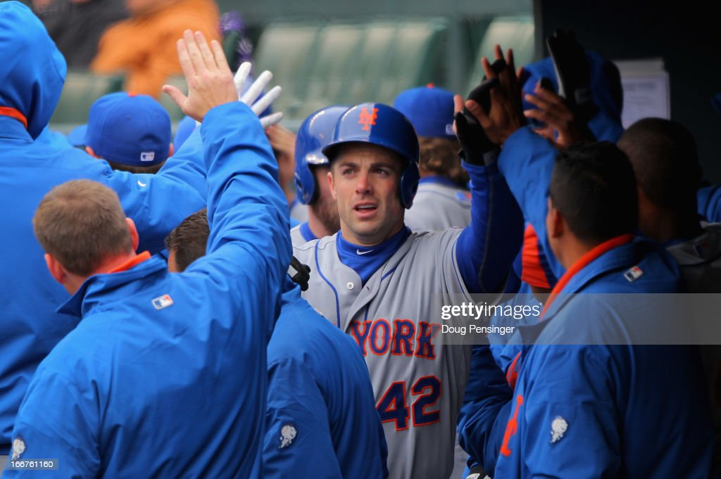 <a gi-track='captionPersonalityLinkClicked' href=/galleries/search?phrase=David+Wright+-+Baseball+Player&family=editorial&specificpeople=209172 ng-click='$event.stopPropagation()'>David Wright</a> of the New York Mets is welcomed back to the dugout after his two run homerun against the Colorado Rockies to give the Mets a 2-0 lead in the first inning at Coors Field on April 16, 2013 in Denver, Colorado. All uniformed team members are wearing jersey number 42 in honor of Jackie Robinson Day.