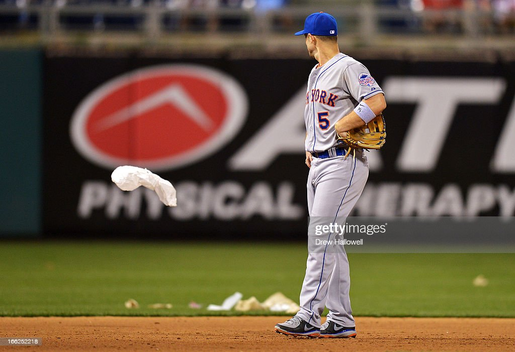 <a gi-track='captionPersonalityLinkClicked' href=/galleries/search?phrase=David+Wright+-+Baseball+Player&family=editorial&specificpeople=209172 ng-click='$event.stopPropagation()'>David Wright</a> #5 of the New York Mets looks at the trash blowing around in right field as a storm approaches during the game against the Philadelphia Phillies at Citizens Bank Park on April 10, 2013 in Philadelphia, Pennsylvania. The Phillies won 7-3.