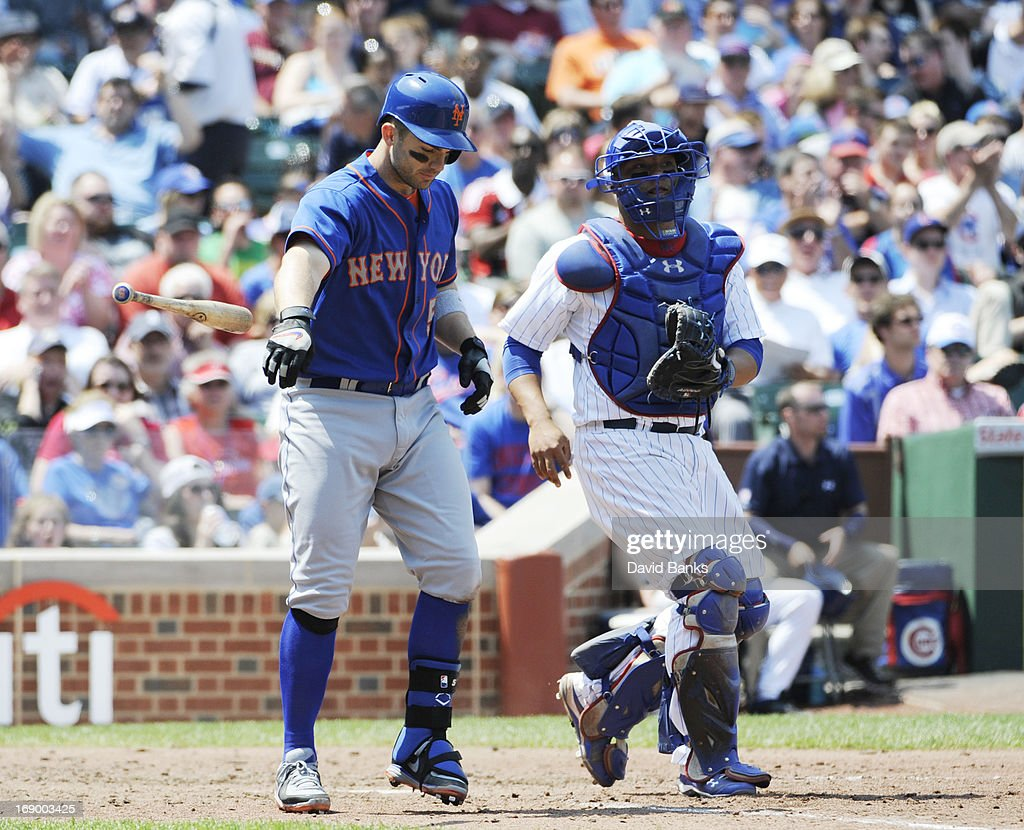 <a gi-track='captionPersonalityLinkClicked' href=/galleries/search?phrase=David+Wright+-+Baseball+Player&family=editorial&specificpeople=209172 ng-click='$event.stopPropagation()'>David Wright</a> #5 of the New York Mets reacts after striking out during the fifth inning as <a gi-track='captionPersonalityLinkClicked' href=/galleries/search?phrase=Welington+Castillo&family=editorial&specificpeople=4959193 ng-click='$event.stopPropagation()'>Welington Castillo</a> #53 of the Chicago Cubs watches on May 18, 2013 at Wrigley Field in Chicago, Illinois.