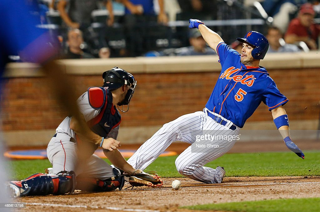 David Wright #5 of the New York Mets scores as he slides in to home on an RBI triple by Michael Cuddyer #23 in the fifth inning against catcher Blake Swihart #23 of the Boston Red Sox on August 28, 2015 at Citi Field in the Flushing neighborhood of the Queens borough of New York City.