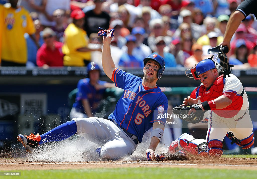 David Wright #5 of the New York Mets scores on an infield popup by Chris Young #1, before Carlos Ruiz #5 of the Philadelphia Phillies can apply the tag during the fourth inning in a game at Citizens Bank Park on June 1, 2014 in Philadelphia, Pennsylvania.