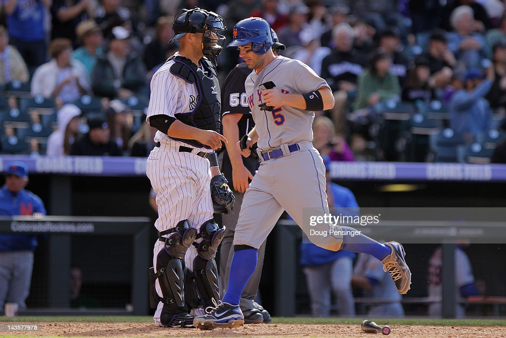 <a gi-track='captionPersonalityLinkClicked' href=/galleries/search?phrase=David+Wright+-+Baseball+Player&family=editorial&specificpeople=209172 ng-click='$event.stopPropagation()'>David Wright</a> #5 of the New York Mets scores the game winning run on a single by Ike Davis #29 of the New York Mets in the 11th inning against the Colorado Rockies at Coors Field on April 29, 2012 in Denver, Colorado. The Mets defeated the Rockies 6-5 in 11 innings.