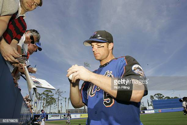 David Wright of the New York Mets signs autographs before the Spring Training game against the Washington Nationals at Tradition Stadium on March 6...