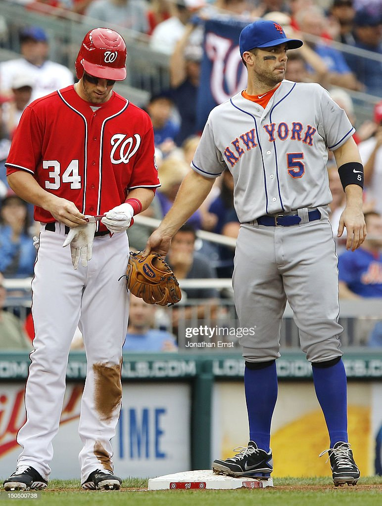 <a gi-track='captionPersonalityLinkClicked' href=/galleries/search?phrase=David+Wright+-+Baseball+Player&family=editorial&specificpeople=209172 ng-click='$event.stopPropagation()'>David Wright</a> #5 of the New York Mets taps <a gi-track='captionPersonalityLinkClicked' href=/galleries/search?phrase=Bryce+Harper&family=editorial&specificpeople=5926486 ng-click='$event.stopPropagation()'>Bryce Harper</a> #34 of the Washington Nationals on the leg with his glove after Harper's triple during the third inning of their game at Nationals Park on August 19, 2012 in Washington, DC.