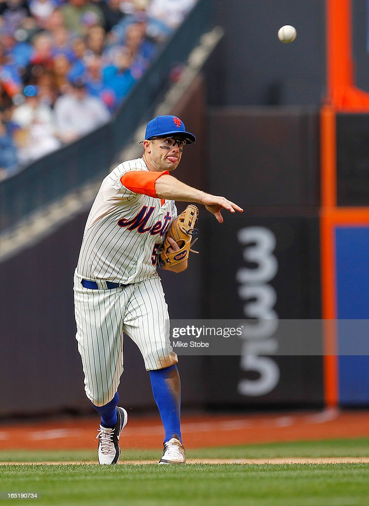 <a gi-track='captionPersonalityLinkClicked' href=/galleries/search?phrase=David+Wright+-+Baseball+Player&family=editorial&specificpeople=209172 ng-click='$event.stopPropagation()'>David Wright</a> #5 of the New York Mets throws out a base runner during the opening day game against the San Diego Padres at Citi Field on April 1, 2013 in the Flushing neighborhood of the Queens borough of New York City.