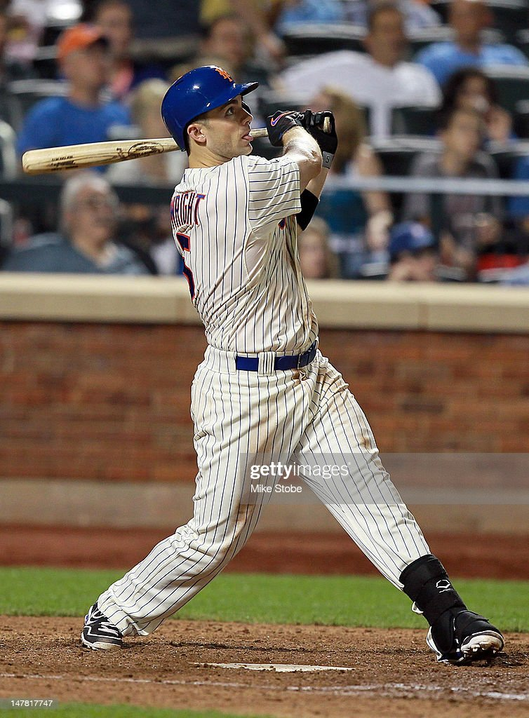 <a gi-track='captionPersonalityLinkClicked' href=/galleries/search?phrase=David+Wright+-+Baseball+Player&family=editorial&specificpeople=209172 ng-click='$event.stopPropagation()'>David Wright</a> #5 of the New York Mets watches his three-run homer in the sixth inning against the Philadelphia Phillies at Citi Field on July 3, 2012 in the Flushing neighborhood of the Queens borough of New York City.
