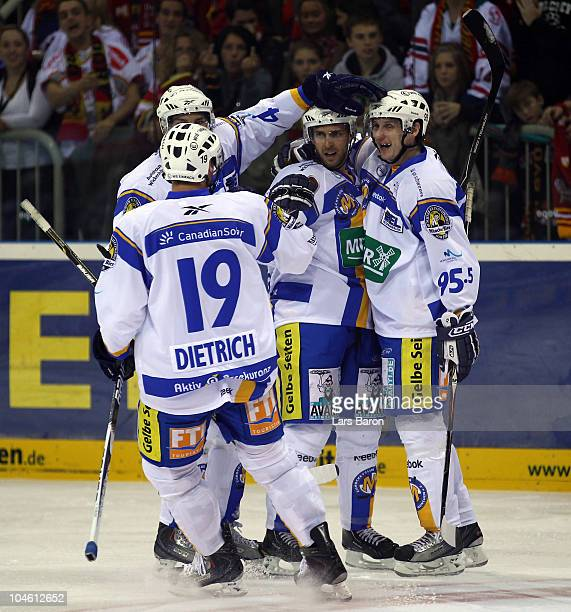 David Wrigley of Muenchen celebrates with team mates after scoring his teams first goal during the DEL match between DEG Metro Stars and EHC Muenchen...