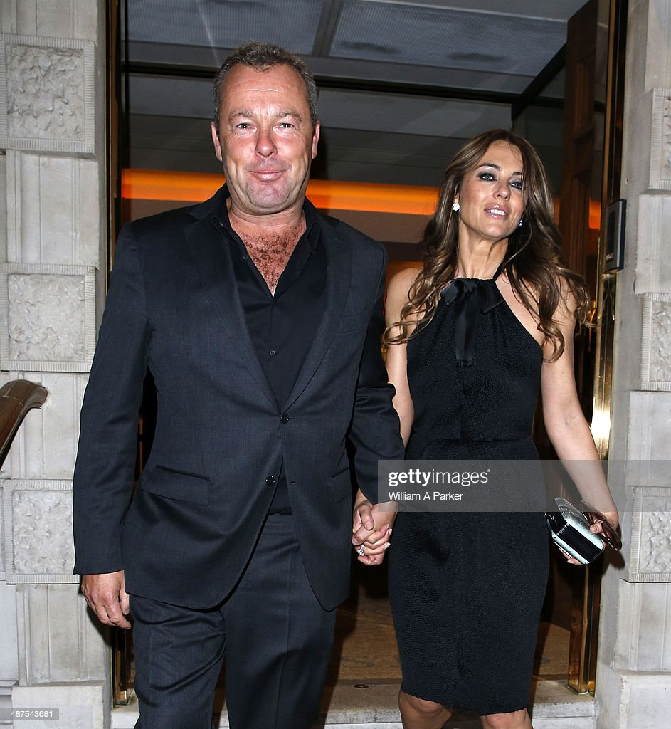 David Yarrow and Elizabeth Hurley seen leaving Chirstie's Conservation Lectures 2014 on April 30, 2014 in London, England.