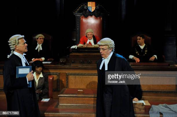 David Yelland as Sir Wilfrid Robarts and Philip Franks as Mr Myres QC with artists of the company in a production of Agatha Christie's Witness for...
