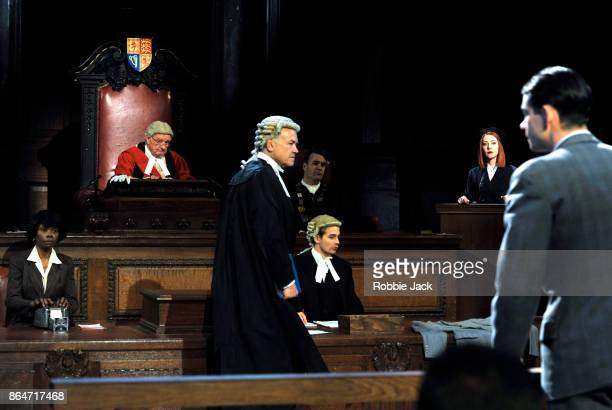 David Yelland as Sir Wilfrid Robarts Jack Mullen as Leonard Vole and Catherine Steadman as Romaine with artists of the company in a production of...