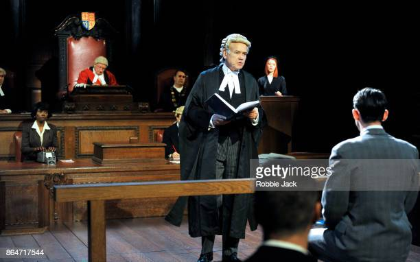 David Yelland as Sir Wilfrid Robarts with artists of the company in a production of Agatha Christie's Witness for the Prosecution directed by Lucy...