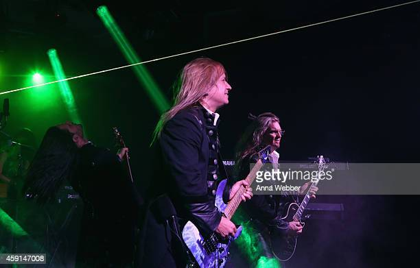 David Z Chris Caffery and Joel Hoekstra of TransSiberian Orchestra perform onstage during an exclusive performance at The iHeartRadio Theater in New...