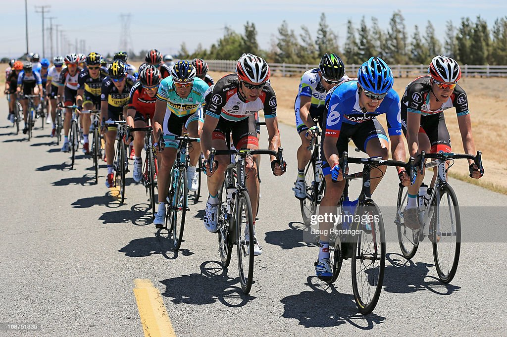 David Zabriskie of the USA riding for Garmin-Sharp (2R) and Jens Voigt (C) of Germany riding for Radioshack Leopard Trek work at the front of a breakaway of 23 riders that failed early in Stage Three of the 2013 Amgen Tour of California from Palmdale to Santa Clarita on May 14, 2013 in Palmdale, California.