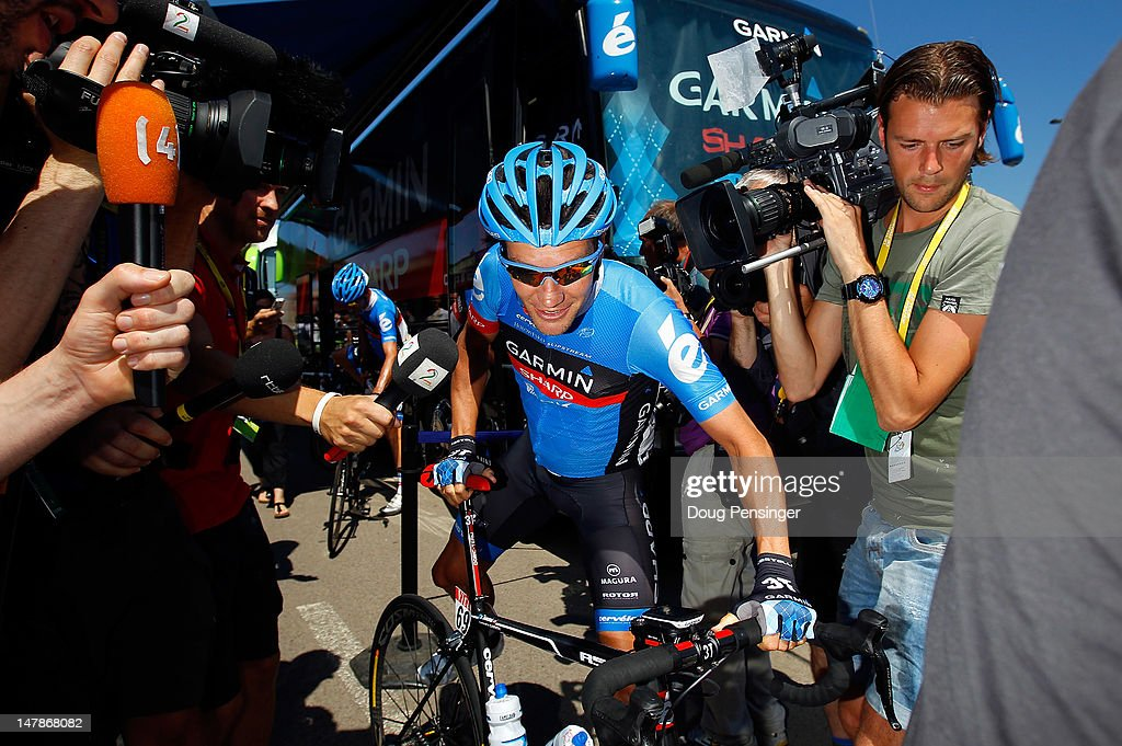 <a gi-track='captionPersonalityLinkClicked' href=/galleries/search?phrase=David+Zabriskie&family=editorial&specificpeople=560617 ng-click='$event.stopPropagation()'>David Zabriskie</a> of the USA riding for Garmin-Sharp is surrounded by the media as he prepares for the start of stage five of the 2012 Tour de France from Rouen to Saint-Quentin on July 5, 2012 in Rouen, France. It is reported that Zabriskie and four others have agreed to give evidence to the US Anti Doping Agency in the latest investigation of Lance Armstrong.