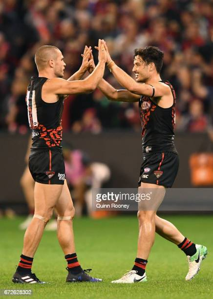 David Zaharakis and Ben McNiece of the Bombers celebrate winning the round five AFL match between the Essendon Bombers and the Collingwood Magpies at...