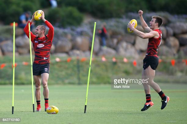 David Zaharakis and Zach Merrett  of Essendon Bombers celebrate a win in a training drill during the Essendon Bombers AFL Family Day at Essendon...