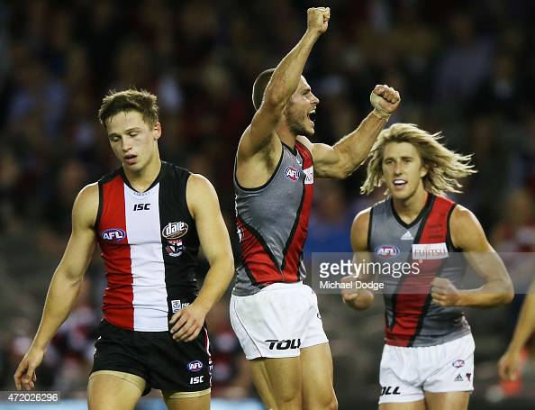 David Zaharakis of the Bombers celebrates a goal next to Jack Billings of the Saints during the round five AFL match between the St Kilda Saints and...