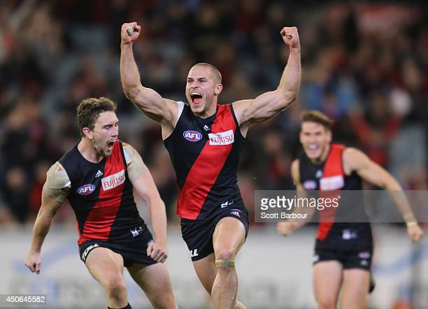 David Zaharakis of the Bombers celebrates after kicking a goal during the round 13 AFL match between the Essendon Bombers and the Melbourne Demons at...