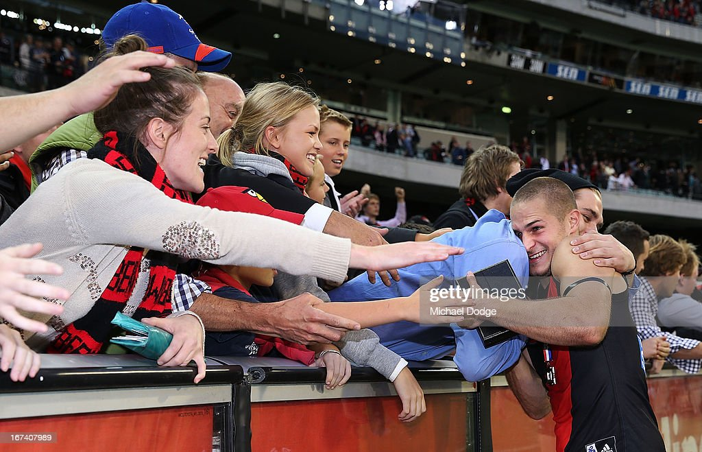 David Zaharakis of the Bombers celebrates the win with fans during round five AFL match between the Essendon Bombers and the Collingwood Magpies at Melbourne Cricket Ground on April 25, 2013 in Melbourne, Australia.