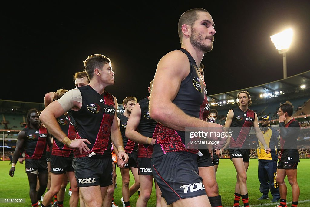<a gi-track='captionPersonalityLinkClicked' href=/galleries/search?phrase=David+Zaharakis&family=editorial&specificpeople=5629221 ng-click='$event.stopPropagation()'>David Zaharakis</a> of the Bombers leads the team off after defeat during the round 10 AFL match between the Essendon Bombers and the Richmond Tigers at Melbourne Cricket Ground on May 28, 2016 in Melbourne, Australia.