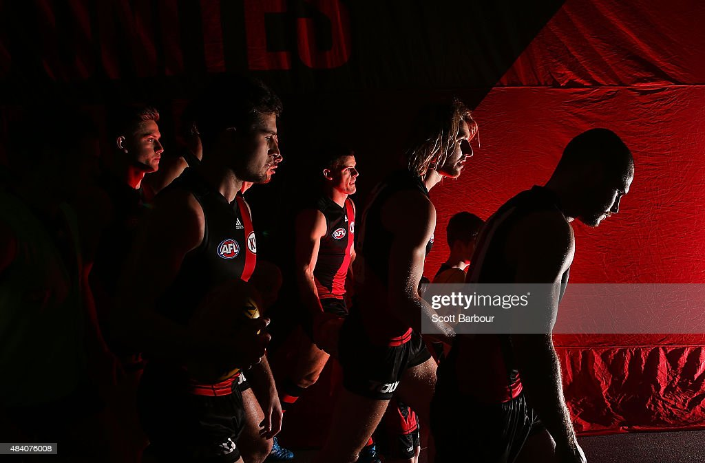David Zaharakis of the Essendon Bombers and Dyson Heppell of the Essendon Bombers lead the players onto the field during the round 20 AFL match...