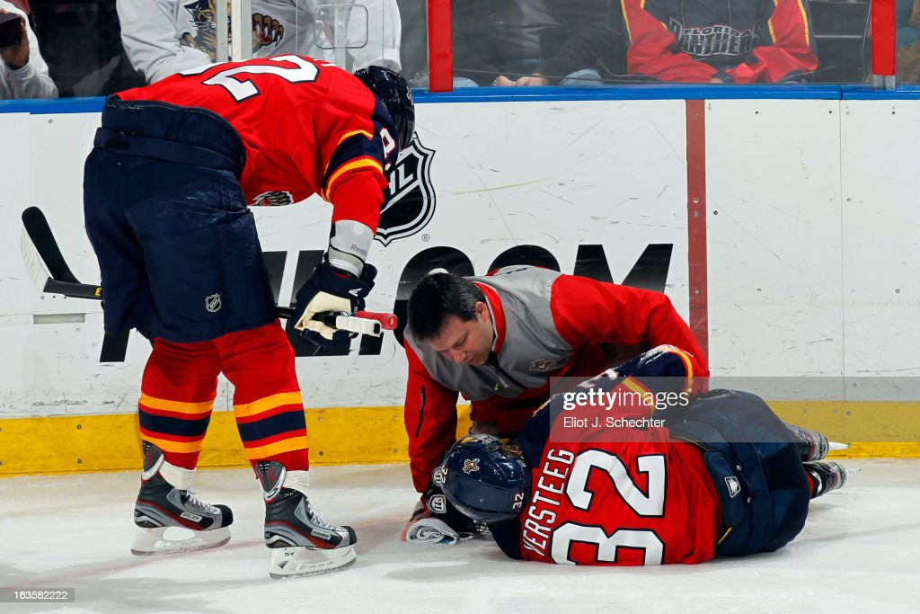 David Zenobi Head Athletic Trainer of the Florida Panthers checks over <a gi-track='captionPersonalityLinkClicked' href=/galleries/search?phrase=Kris+Versteeg&family=editorial&specificpeople=2242969 ng-click='$event.stopPropagation()'>Kris Versteeg</a> #32 after an incident on the ice. Teammate <a gi-track='captionPersonalityLinkClicked' href=/galleries/search?phrase=Tomas+Kopecky&family=editorial&specificpeople=2234349 ng-click='$event.stopPropagation()'>Tomas Kopecky</a> #82 is near by for support against the Tampa Bay Lightning at the BB&T Center on March 12, 2013 in Sunrise, Florida.