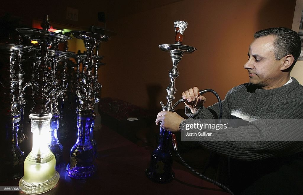 David Zoumut, owner of Hookah Nites Cafe, prepares a hookah pipe for a customer January 18, 2006 in San Jose, California. The ancient Middle-Eastern practice of smoking flavored tobaccos through a tall, ornate water pipe, better known as hookah, has become increasingly popular throughout the United States. Hookah lounges are becoming trendy in college towns and are appealing to people from all walks of life.