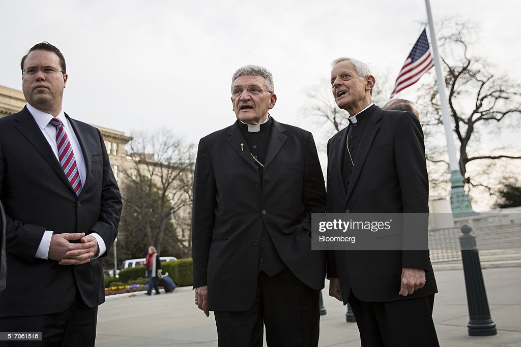 David Zubik, bishop of the Diocese of Pittsburgh and lead plaintiff in the Zubik v. Burwell case, center left, and Cardinal Donald Wuerl, archbishop of Washington, stand outside of the Supreme Court in Washington, D.C., U.S., on Wednesday, March 23, 2016. On Wednesday morning, the Supreme Court is scheduled to hear oral arguments in Zubik v. Burwell, a consolidated case brought by religious groups challenging a process for opting out of the Affordable Care Act's contraception mandate. Photographer: Drew Angerer/Bloomberg via Getty Images