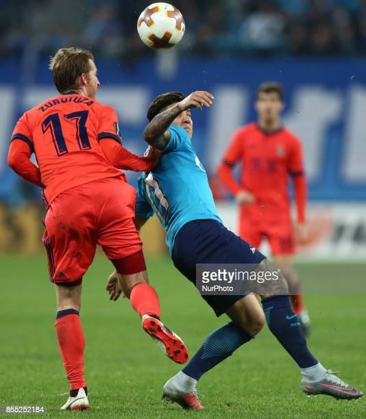 David Zurutuza of FC Real Sociedad and Sebastian Driussi of FC Zenit Saint Petersburg vie for the ball during the UEFA Europa League Group L football...