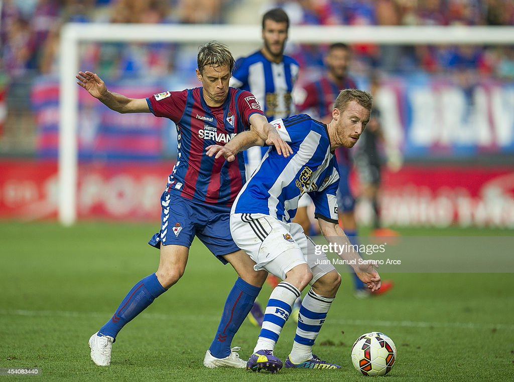 David Zurutuza of Real Sociedad duels for the ball with Javier Lara of SD Eibar during the La Liga match between SD Eibar and Real Sociedad at Ipurua Municipal Stadium on August 24, 2014 in Eibar, Spain.