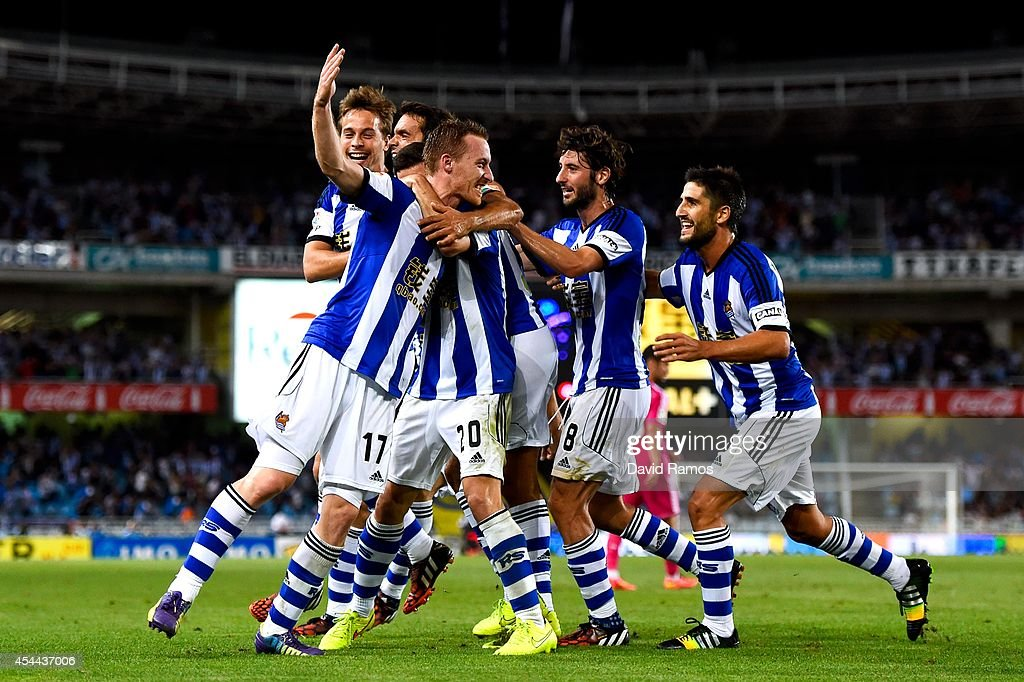 David Zurutuza Veillet (L) of Real Sociedad celebrates with his teammates after scoring his team's third goal during the La Liga match between Real Sociedad de Futbol and Real Madrid CF at Estadio Anoeta on August 31, 2014 in San Sebastian, Spain.