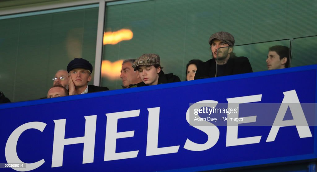 Davida and Brooklyn Beckham watch the game during the Emirates FA Cup, Quarter Final match at Stamford Bridge, London.