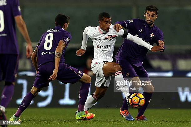 Davide Astori and Matias Vecino of ACF Fiorentina battles for the ball with Robin Quaison of US Citta' di Palermo during the Serie A match between...