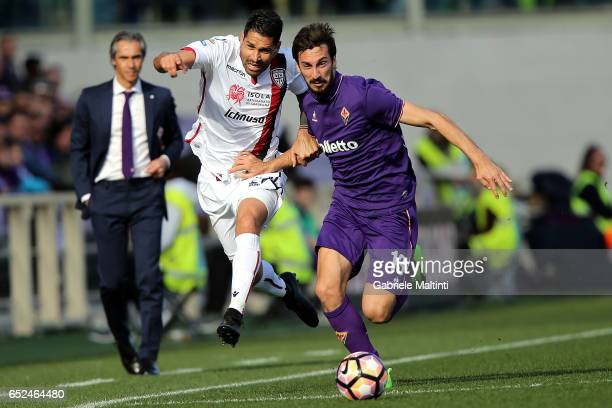 Davide Astori of ACF Fiorentina battles for the ball with Marco Borriello of Cagliari Calcio during the Serie A match between ACF Fiorentina and...