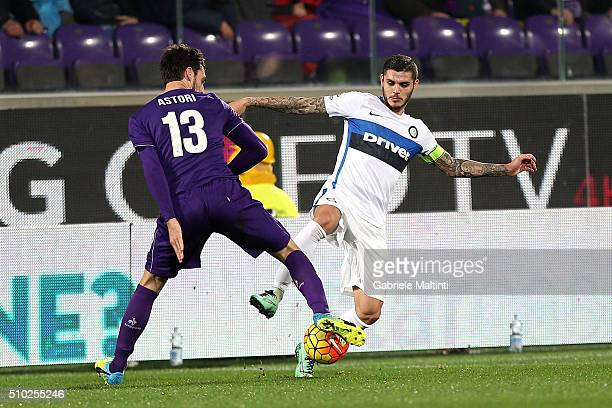 Davide Astori of ACF Fiorentina battles for the ball with Mauro Icardi of FC Internazionale Milano during the Serie A match between ACF Fiorentina...