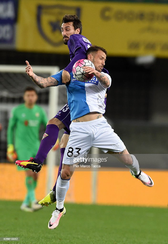 <a gi-track='captionPersonalityLinkClicked' href=/galleries/search?phrase=Davide+Astori&family=editorial&specificpeople=5658888 ng-click='$event.stopPropagation()'>Davide Astori</a> of ACF Fiorentina competes for the ball with Antonio Floro Flores of AC Chievo during the Serie A match between AC Chievo Verona and ACF Fiorentina at Stadio Marc'Antonio Bentegodi on April 30, 2016 in Verona, Italy.