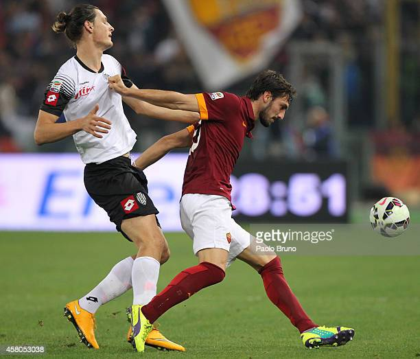 Davide Astori of AS Roma competes for the ball with Milan Djuric of AC Cesena during the Serie A match between AS Roma and AC Cesena at Stadio...