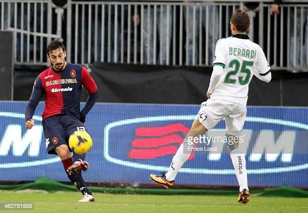 Davide Astori of Cagliari and Berardi Domenico of Sassuolo compete for the ball during the Serie A match between Cagliari Calcio and US Sassuolo...
