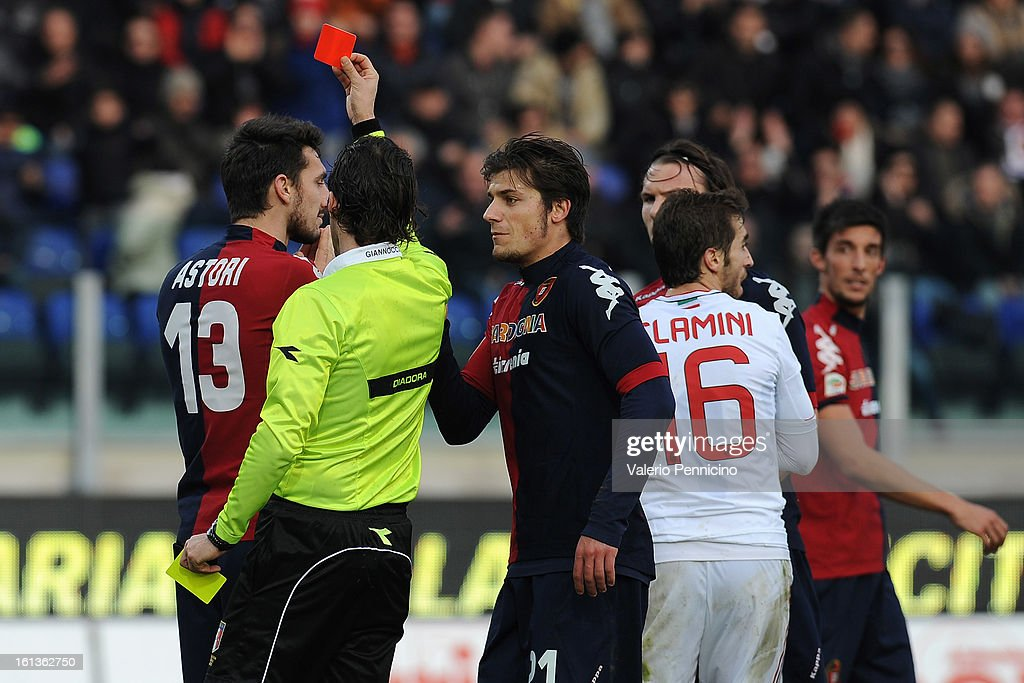 <a gi-track='captionPersonalityLinkClicked' href=/galleries/search?phrase=Davide+Astori&family=editorial&specificpeople=5658888 ng-click='$event.stopPropagation()'>Davide Astori</a> (L) of Cagliari Calcio receives the red card from referee Giannoccaro during the Serie A match between Cagliari Calcio and AC Milan at Stadio Is Arenas on February 10, 2013 in Cagliari, Italy.