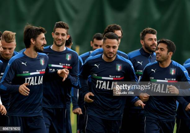 Davide Astori Roberto Gagliardini Danilo D'Ambrosio and Eder of Italy chat during the training session at the club's training ground at Coverciano on...