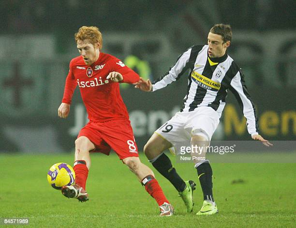 Davide Biondini of Cagliari and Claudio Marchisio of Juventus during the Serie A match between Juventus and Cagliari at the Olimpico Stadio on...