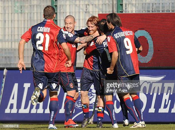 Davide Biondini of Cagliari celebrates with his mates after scoring his goal during the Serie A match between Cagliari Calcio and US Citta di Palermo...